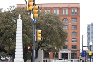 The Texas School Book Depository driving up Houston St. Same direction in which JFK rode.