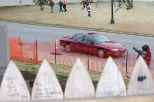 This shows a car driving over the X marking the exactly location of the head shot from the perspective of the shooter.