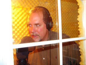 Working the mic in Total Broadcasting Service's former studio booth.